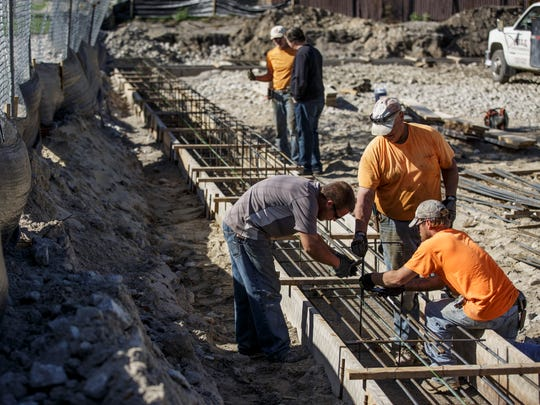 Contractors work on the foundation for exterior walls for The Inn on Water Street Wednesday, Oct. 19, 2016 in Marine City.