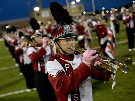 Members of the Port Huron High School marching band perform during the 2015 Crosstown Showdown.