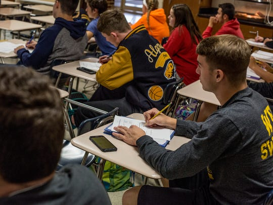 Ozzy Kinch, 17, takes notes during an International Baccalaureate sports, exercise and health science class Thursday, Oct. 27, 2016 at Algonac High School.