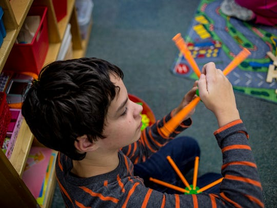 Student Christopher Shaffer, 13, spins a toy during an open play time Thursday, Dec. 1, 2016 in Tammy Brown's classroom at Woodland Developmental Center in Marysville.