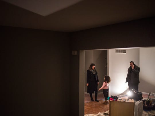 Brian and Christine Fitzpatrick walk through their new home with their daughter, Alia, 6, Thursday, Jan. 5, 2017 in Fort Gratiot.