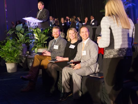 40 Under 40 honorees, seated from left,  Chris Barksdale, Patsy Bragg and Richard Brown greet Amanda Butterworth on Jan. 19 at the Knoxville Convention Center.