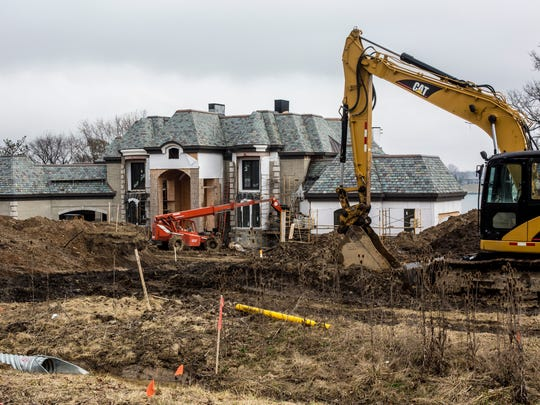 Construction is underway on a new home Friday, Feb. 24, 2017 on River Road in St. Clair Township. Construction of new homes are rising in St. Clair County. Ira Township currently has 10 new home projects in various stages, while St. Clair Township has about 20 new homes in progress.
