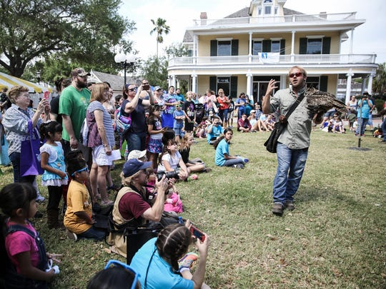 Jordan Turner of Sky Kings Falconry discusses birds of flight during the annual Earth Day Bay Day at Heritage Park on April 9, 2016.