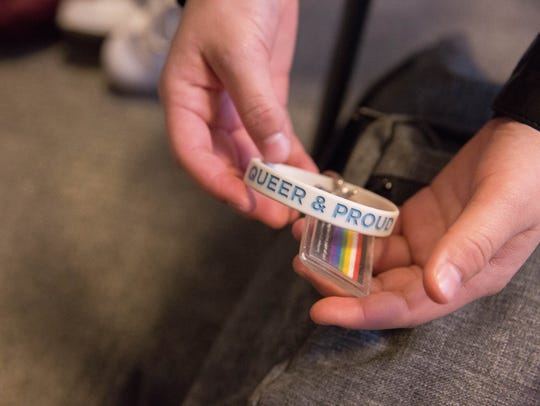 Gabe, a local transgender teen, shows off a key chain on his backpack in 2017.