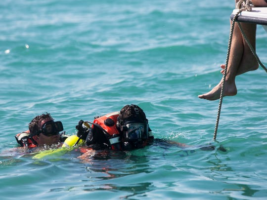 Robert Hardy, right, and Mike Popper prepare to search the bottom of the ocean for a simulated missing diver during a training exercise on Tuesday, May 16, 2017, in Naples, Fla. The emergency drill was part of an annual multi-agency marine emergency response team training, a countywide effort to prepare for waterway-related emergencies and coordinate between federal, state and local agencies.