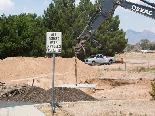 Crews work to connect city utilities to the Park Ridge development, which will allow for construction of a medical center and hospital on the site of the old Las Cruces Country Club. Wednesday, June,7, 2017.