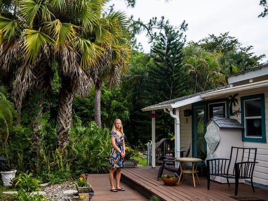Lizzy Washburn, 33, stands outside her home, which she has owned for less than a year, in East Naples on Tuesday, June 20, 2017. Washburn teaches math at Community School of Naples and is a first-time homebuyer.