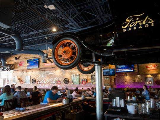 Customers dine at Ford's Garage on Thursday, June 29,
