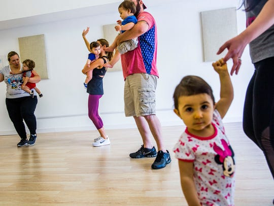 Parents and their babies participate in a Zumbini class instructed by Tina Bennett at Family in Motion studio on Monday, Aug. 21, 2017, in East Naples.