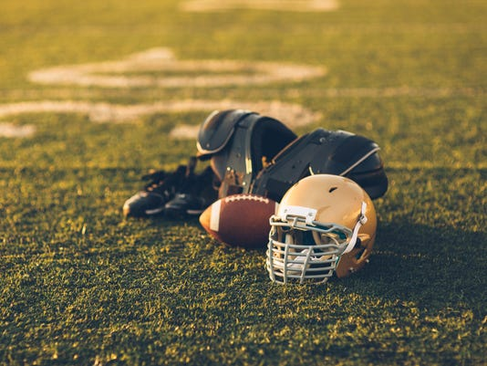 Gold Football Helmet on Field