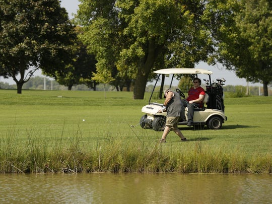 A golfer hits a ball Friday, Sept. 15, 2017, at Lakeshore Municipal Golf Course in Oshkosh.