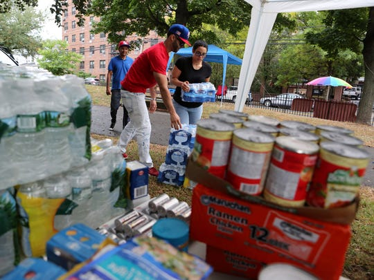 Vanessa Capllonch, 31, right, of Yonkers helps Emanuel Bonilla Rivera, 30, of Yonkers with his donations for hurricane victims in Puerto Rico Oct. 8, 2017 at O'Boyle Park in Yonkers. The Puerto Rican Cultural Foundation, Inc., and the Dominican Cultural Association of Yonkers organized the relief event.