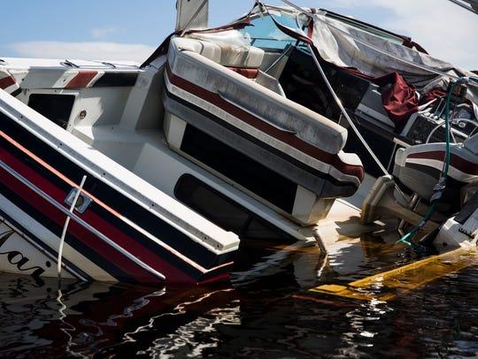 A sunken boat sits in the Imperial River in Bonita
