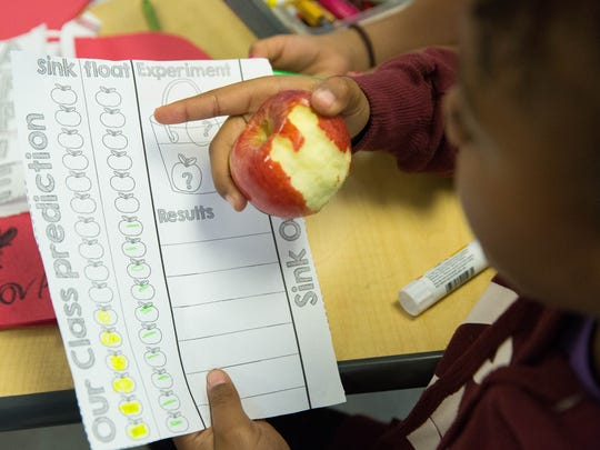 Mikayla Oveid, 7, a first-grade student at Valley View Elementary School, explains a class project that she and other students in Courtney Degler's class are working on during Apple Crunch Week on Tuesday October 24, 2017. Teachers and students  throughout Las Cruces Public Schools will be trying different types of apples every day this week. This program is intended to help students eat healthier, and was funded through the SNAP-Ed  grant from the United State Department of Agriculture.