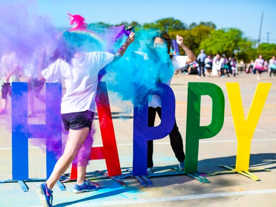 Participants of a recent event of The Color Run enjoy