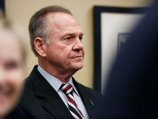 Former Alabama Chief Justice and U.S. Senate candidate Roy Moore waits to speak at the Vestavia Hills public library Saturday in Birmingham, Alabama.