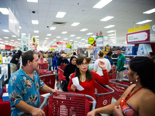 Shoppers crowd the electronics section on Thursday,