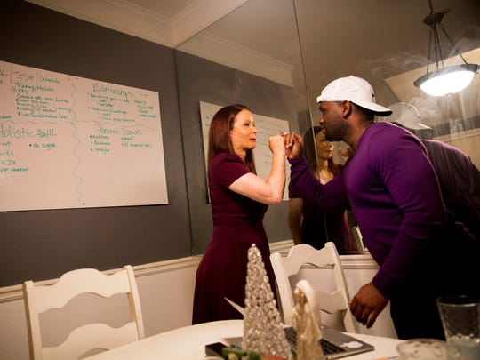 "Audrey Mabrey shares a moment with her boyfriend, David Prosper, after the couple completed a list of goals for the week in their home Sunday, Dec. 10, 2017, in Bradenton, Fla. ""He's the most goal-oriented person I've ever met,"" said Mabrey of Prosper. ""He's everything I was looking for in a partner."""