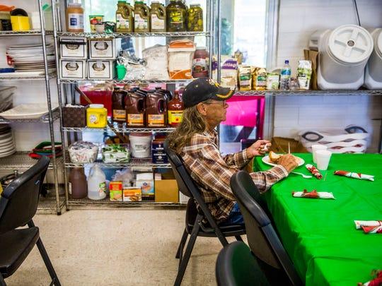 Del Petrik, 60, has a free Christmas meal at St. Matthew's