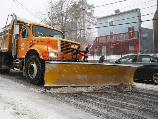 A Village of Wappingers Falls plow truck clears snow