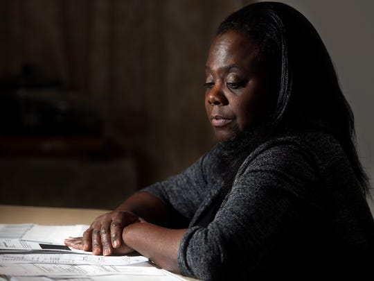 Deloris Ritchie of Hillcrest sits with the paperwork