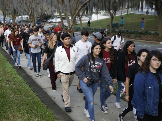 Marjory Stoneman Douglas High School students walk
