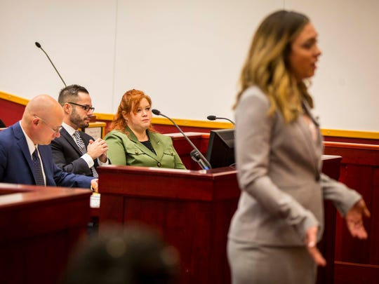 Sera Alexander, center, listens to assistant Polk County attorney Shannon Archer during opening remarks at the murder trial for Alexander underway Monday, March 5, 2018, at Drake's Legal Clinic in Des Moines.
