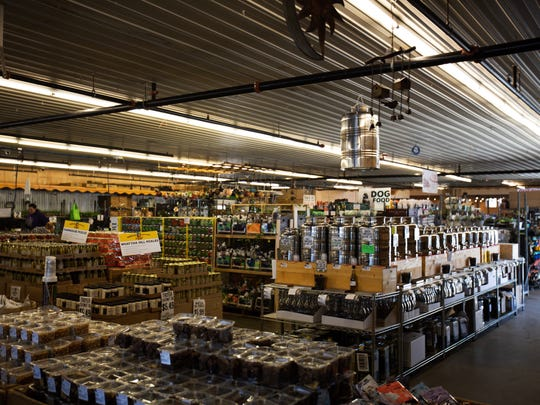 Flavored olive oil and gardening supplies line just one small section at Horrocks Farm Market in Delta Township.