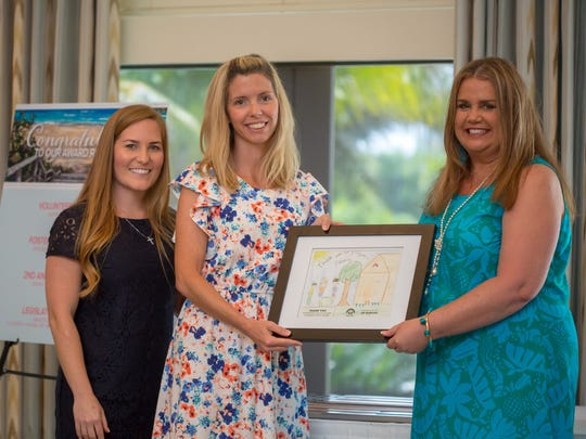 Place of Hope's Jamie Bond, left, Volunteer of the Year recipient Jennifer Burrage and luncheon co-chair Caye Johnson.