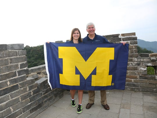 Gov. Rick Snyder with his youngest child, Kelsey, at the Great Wall in China in 2015. Kelsey graduated from U-M last month and is eyeing a career in politics.
