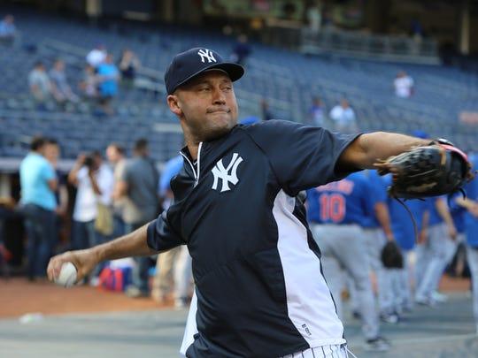 Derek Jeter warming up for a 2013 game.