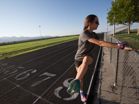 Lucinda Hemingway, a member of the Las Cruces SunDragons Athletics Track and Field Club, demonstrates her typical morning running routine at the Oñate High School track.