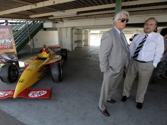 Mark Miles, CEO of Hulman & Co, left, talks to Willy Herrmann, representative of IndyCar in Brazil, before a press conference to launch the Formula Indy at the Nelson Piquet Autodromo in Brasilia, Brazil.