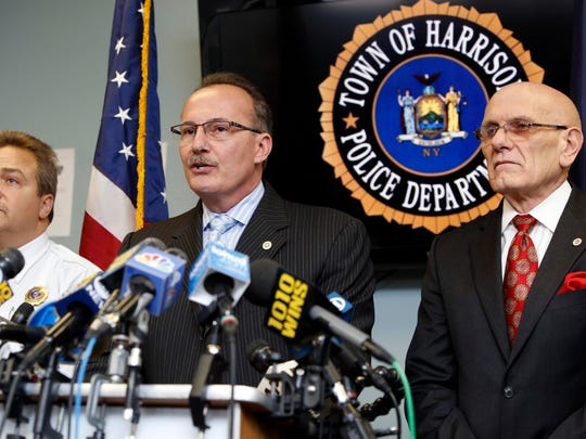 Former Harrison Police Chief Anthony Marraccini, center, at a February 2015 news conference.