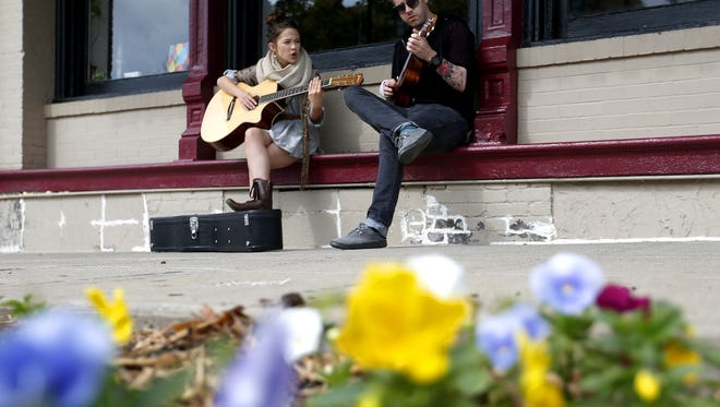 "Springfield native actor Cailee Spaeny is in the Feb. 2018 issue of Vanity Fair for an upcoming Hollywood movie, ""Pacific Rim Uprising."" Here Spaeny strums the guitar and sings with Doug Braudway as he plays the ukulele in downtown Springfield on Oct. 5, 2015."