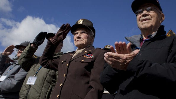 Army nurse Elizabeth Lewis  and veteran Marvin Clark at  the second Veterans Day parade in Old Town Manassas in 2010.