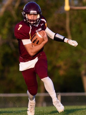 Madison quarterback Josh Giles (7) runs the ball during the first half of their high school football game on Friday, Sept. 8, 2017, at Trojan Field in Madison.