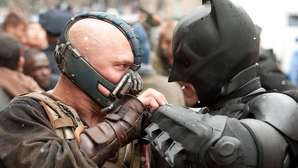 Tom Hardy as Bane and Christian Bale as Batman, appear