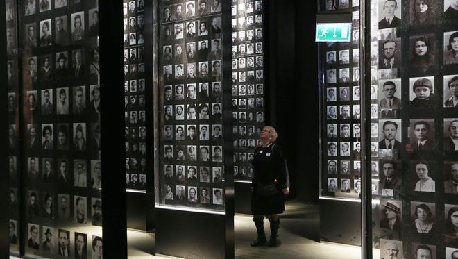 A  visitor  looks at an exhibit in the Museum of the Second World War, an ambitious new museum under creation for nine years has opened its doors for a day to historians, museums and reporters in Gdansk, Poland, on Monday, Jan. 23, 2017.  (AP Photo/Czarek Sokolowski)