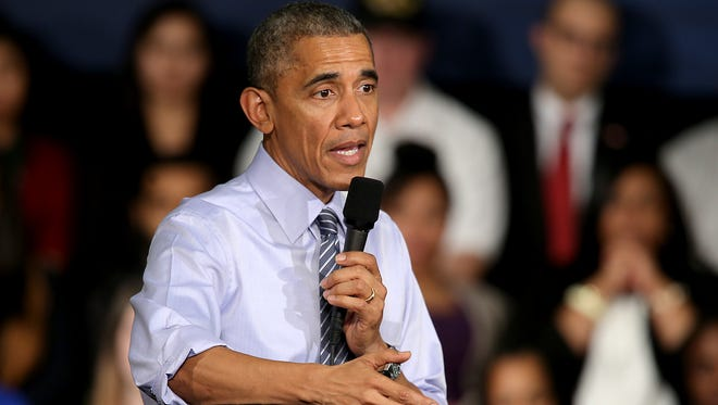 President Barack Obama addresses the crowd during his visit to Ivy Tech Community College Friday, February 6, 2015, in Indianapolis. Obama is visiting to highlight the benefits of Indiana's statewide community college system as part of a national tour to advocate free community college for many students.