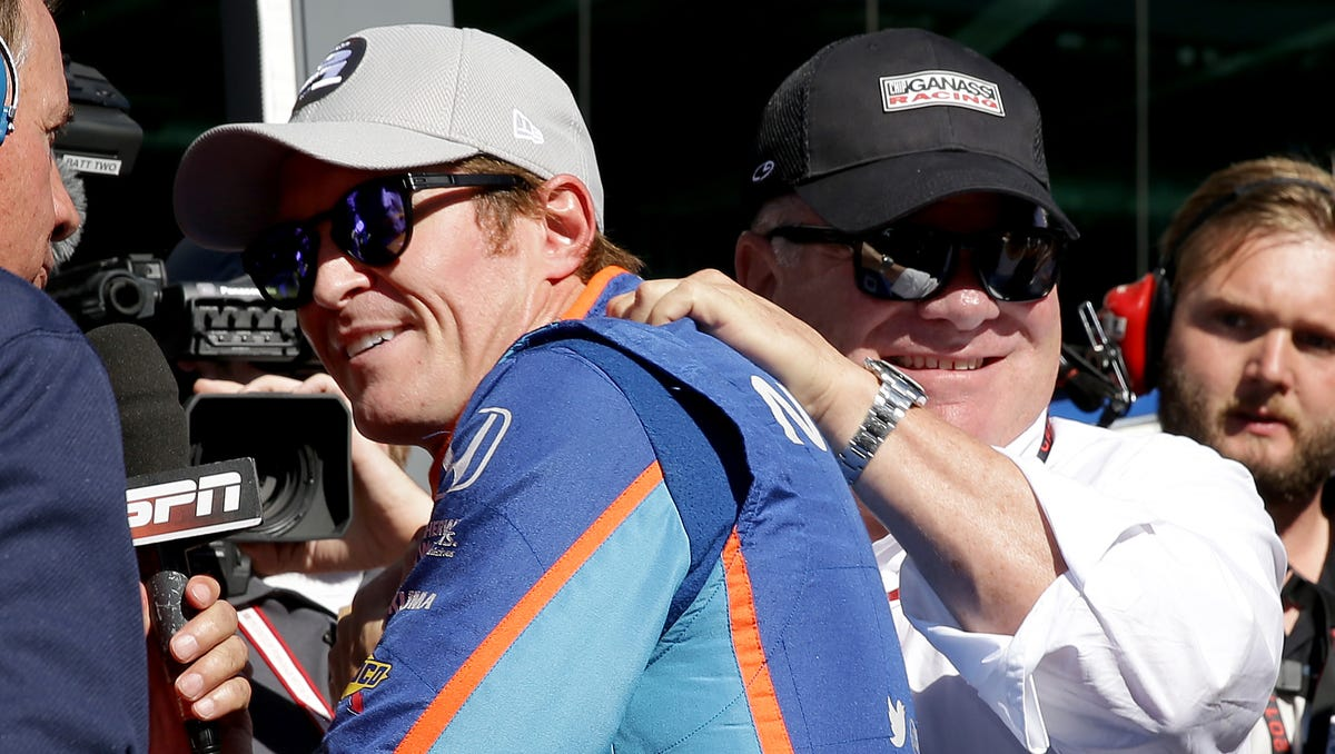 Chip Ganassi Racing IndyCar driver Scott Dixon (9) is congratulated by team owner Chip Ganassi after winning the pole position for the Indianapolis 500 during Armed Forces Pole Day Sunday, May 21, 2017, afternoon at the Indianapolis Motor Speedway.