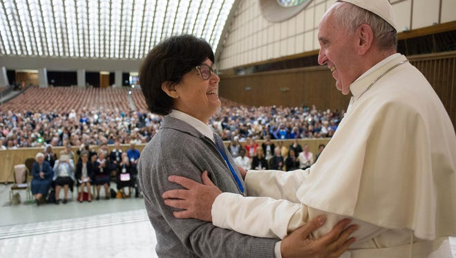 Pope Francis hugs Sister Carmen Sammut, a Missionary Sister of Our Lady of Africa at the end of a special audience with members of the International Union of Superiors General in the Paul VI Hall at the Vatican, Thursday, May 12, 2016.