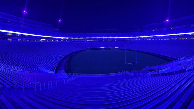Sanford Stadium lit up blue Wednesday night to honor Oconee County High School administrator Brian Deitz, who passed away following a six-year battle with cancer.