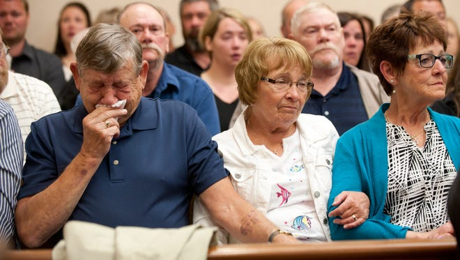 Friends and family of Jeffrey Kebler react during Mitchell Ballinger's sentencing at the Clinton County Circuit Court in St. Johns on Monday, April 25, 2016. Four defendants, Mitchell Ballinger, Manuel Martinez, Dominique Harris and Alexis Pena, were sentenced after pleading guilty to murder charges in the death of 62-year-old Jeffrey Kebler.