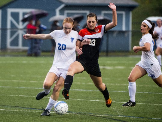 Palmyra's Sophia Wagner battles Lariah Thompson during the Cougars' 3-1 loss to Lower Dauphin at Lower Dauphin Middle School on Tuesday.