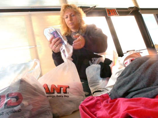 A volunteer at the Clothes Closet at St. Paul's United Methodist Church on First Avenue in Red Lion, folds and bags clothes for a customer. The clothing bank accepts donations of gently used clothing and sells it to the community for about 10 cents to 15 cents per item.