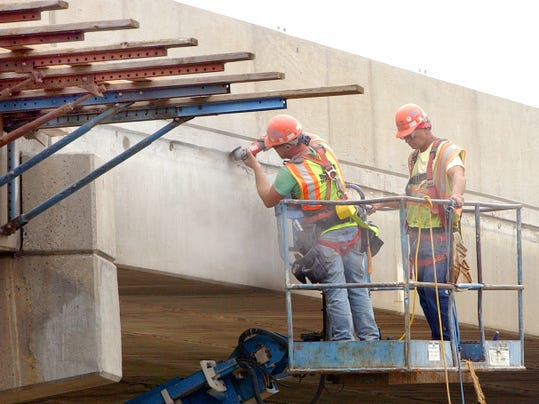 More renovation projects may be coming for Pennsylvania's roads and bridges, if the Shuster-sponsored Surface Transportation Reauthorization and Reform Act also passes the U.S. Senate. In this June 2014 file photo, crews work to replace the bridge deck and parapets over a bridge over I-81 at the Chambersburg borough/Guilford Township line.