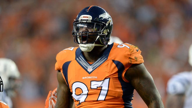 Denver Broncos defensive end Malik Jackson (97) reacts to his sack in the second quarter against the Indianapolis Colts at Sports Authority Field at Mile High.