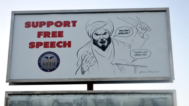 Three billboards depicting the controversial image of Muhammad have been covered up along AR Highway 202 in Summit.